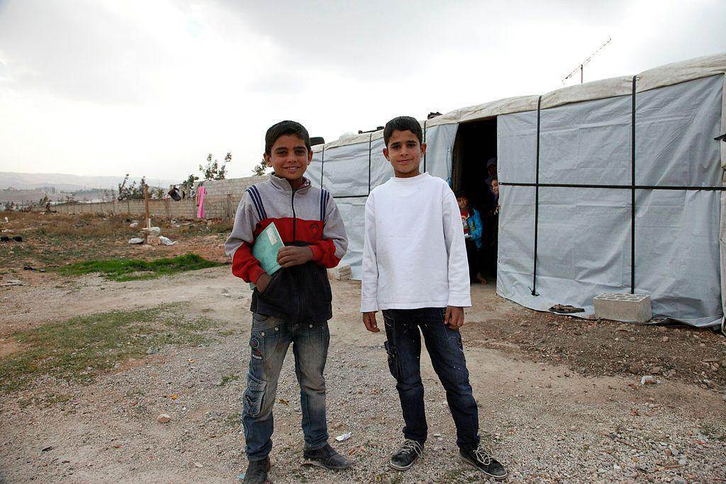 Muhanad and Ahmad*, two Syrian refugee boys outside Ahmad's temporary home, in Lebanon's Bekaa Valley.