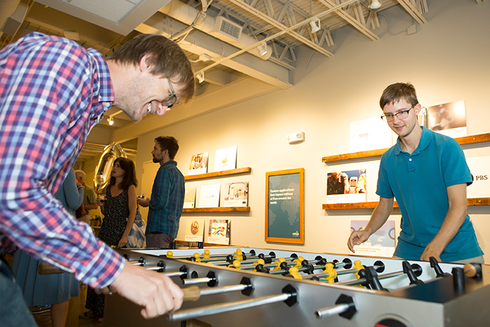 Caktus employees playing a game at the 10th-anniversary party.