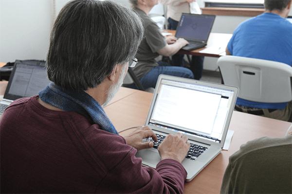 A man at a computer.